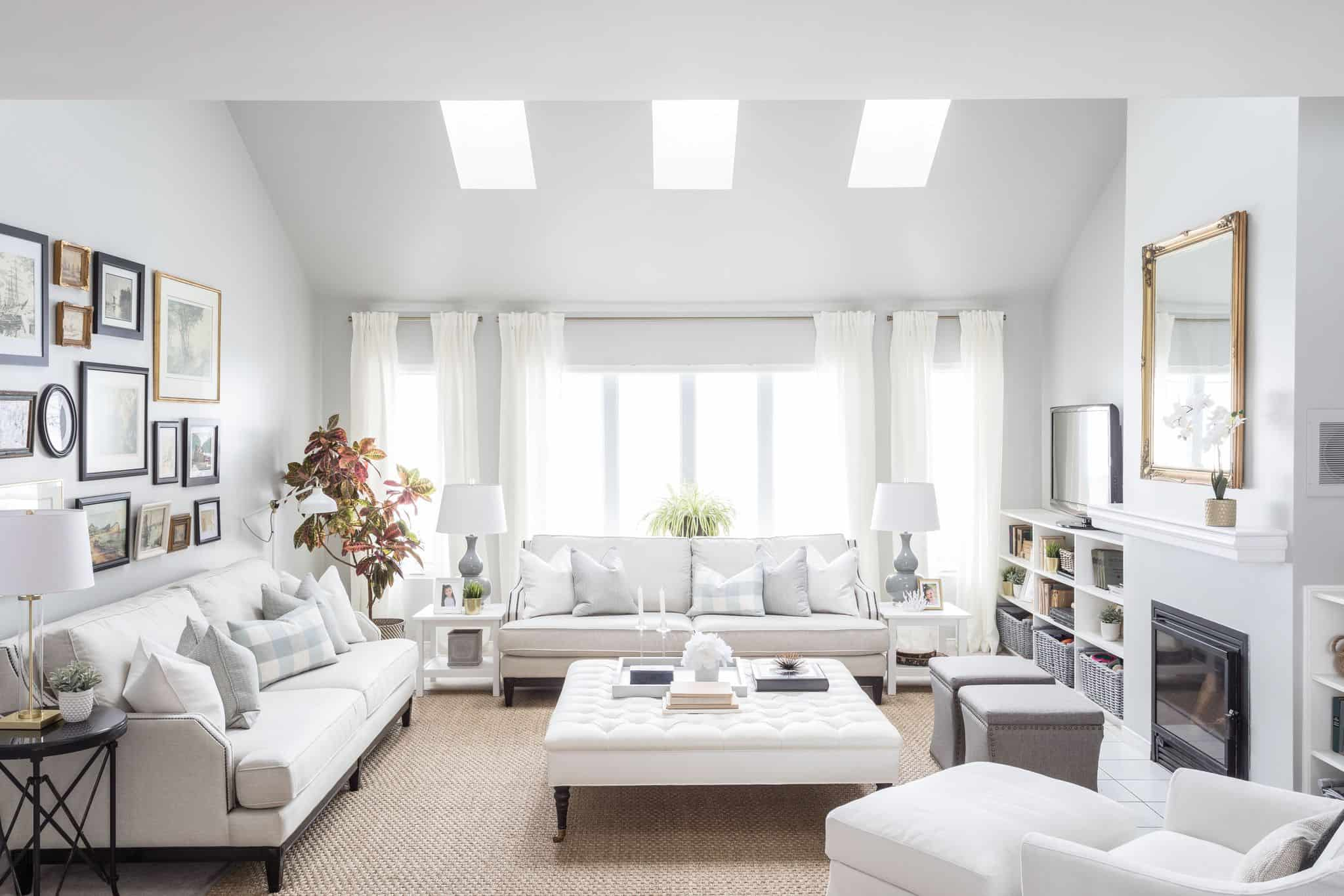 Bright white living room with a bright window above a couch